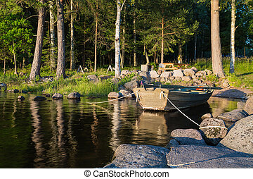 skiff anchored - Lake Skagern a serene recreation site for...