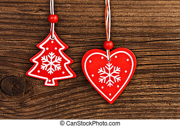 Christmas tree decorations on vintage wooden background
