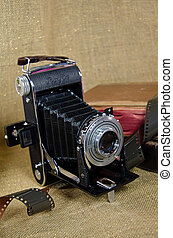 vintage bellows camera - Old-fashioned bellows camera with...