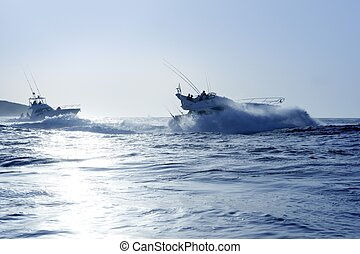 Fishing boat in a big game summer blue morning