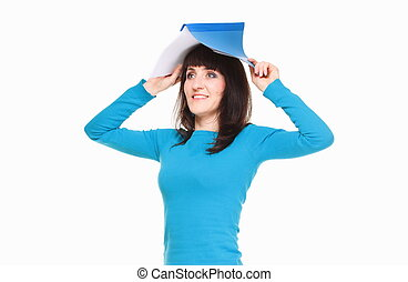 Portrait of business woman with documents on her head