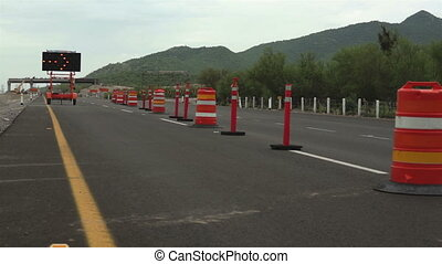 Detour Sign Construction Pylons Far - Long shot of a highway...