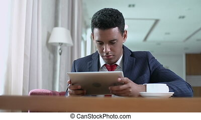 Digital Era - Low angle shot of businessman with digital...