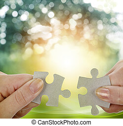 Puzzle pieces - Fingers holding two puzzle pieces