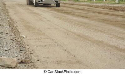 Dump Truck Dirt Road Fast Pan - Fast panning shot of a dump...
