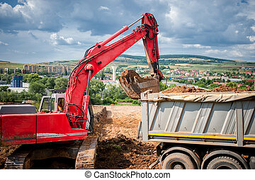 industrial excavator loader with rised backhoe standing in...