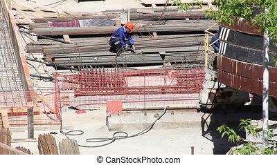 Welder welding metal on construction site