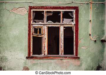 Smashed glass Window with old wooden frame on grunge wall...