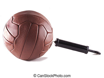 Inflating ball - Pump inflating vintage football, isolated...