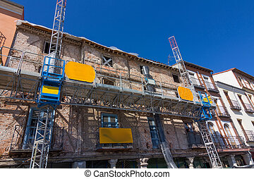 facade of old building in remodeling, retaining outside