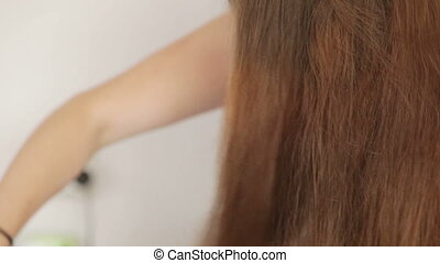Combing with a hair dryer - Young girl doing hair with hair...