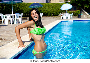 Cute girl reaction while entering in swimming pool with cold...