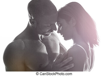 Couple in love enjoying a tender moment as they gently hold...