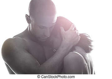 Couple in love holding each other close in a tender...
