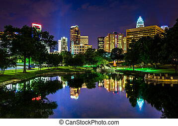 The Charlotte skyline seen at Marshall Park, in Charlotte,...