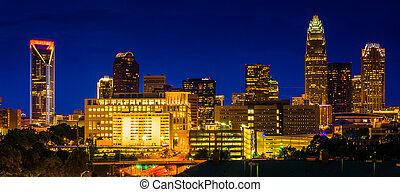 View of the Charlotte skyline at night, North Carolina. -...