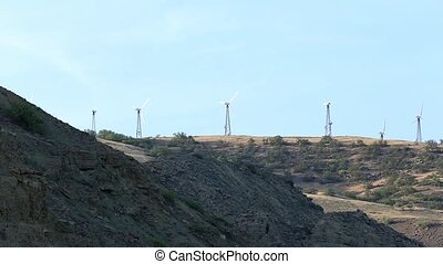 Wind farm in the mountains. Mountain Meganom, Crimea,...