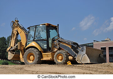 Construction Backhoe - A large yellow construction backhoe...