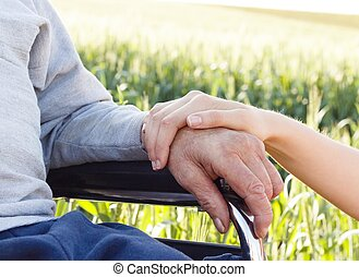 Alzheimers Disease - Supporting hand for grandfather with...