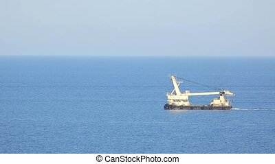 Dredge floating in the the sea