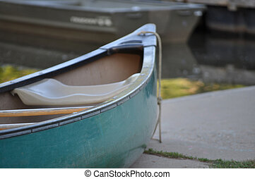 Canoe Front - The front of a green canoe against the water