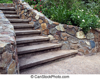 Cascading stone staircase with lush foliage - A cascading...