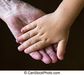 Hands of the old woman and child.
