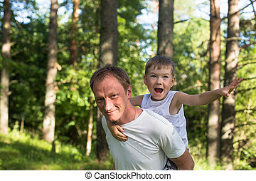 Father with his son play in the Park.