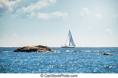 Sailboat in swedish archipelago
