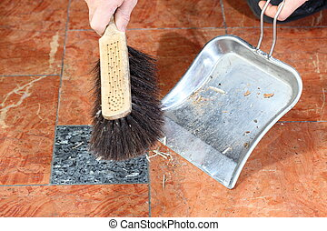 sweeping - hands holding broom and dust pan sweeping up