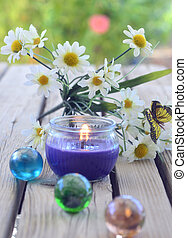 Spa candles flowers on wooden background