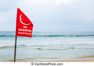 No swimming danger sign at the beach