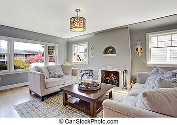 Light grey living room with white sofas and fireplace -...