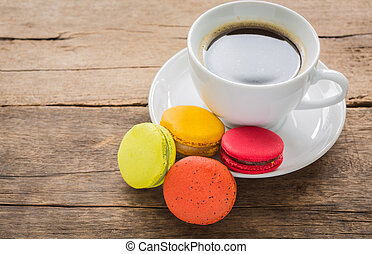 French colorful macarons with cup of coffee
