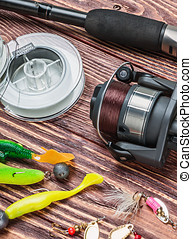 fishing tackle on a wooden table - fishing tackle on a...