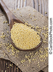 Heap of Millet on a dark vintage wooden table