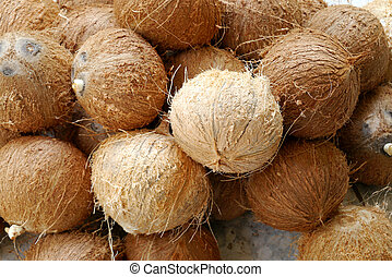 peeling coconuts fruit background