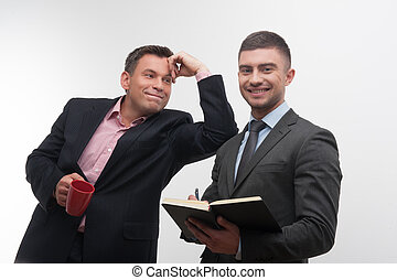 Senior and junior business people discuss something