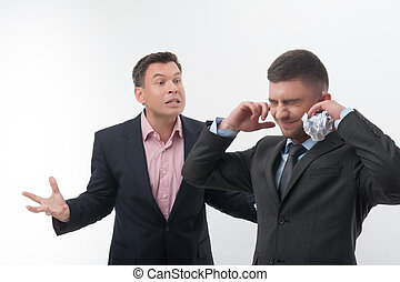 Boss angry with young employee - Senior and junior business...