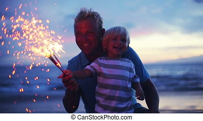 Father and son lighting fireworks - Father and son lighting...