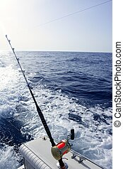 Fishing rod and reel in blue ocean - Fishing rod and reel on...