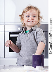 Child having good time in kitchen