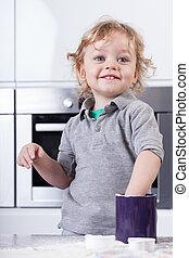 Child having good time in kitchen - Little child having good...