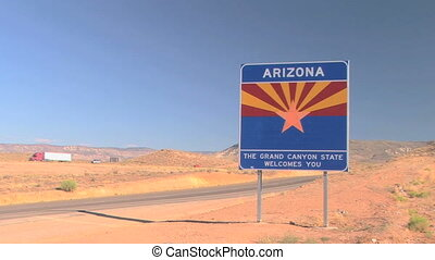 Welcome to Arizona sign, along Interstate 15, time lapse