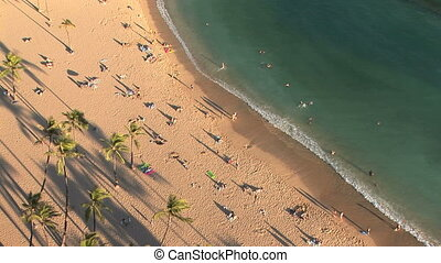 Waikiki Beach - High angle view of tourists on the beach in...