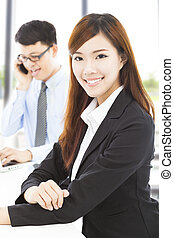 young business woman with colleague in office