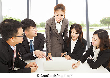business female manager briefing all colleagues in office