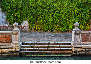 Wharf on the canal in Venice Italy