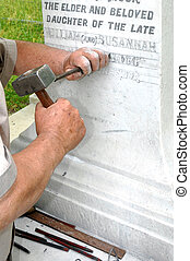 Stonemason Engraving Gravestone - Stonemason using...