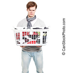 portrait of an unsure young man holding a basket with...